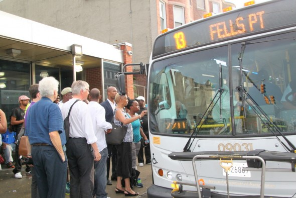 The group finally boards the #13 bus on North Avenue. (Photo by Fern Shen)