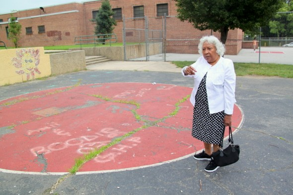 Helena Hicks looking over the aging playground at Gilmor Elementary School. (Photo by Fern Shen)