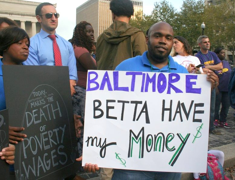 Jammel Davis,a canvasser with Maryland Working Families, shows his support for low-wage workers. (Photo by Danielle Sweeney)