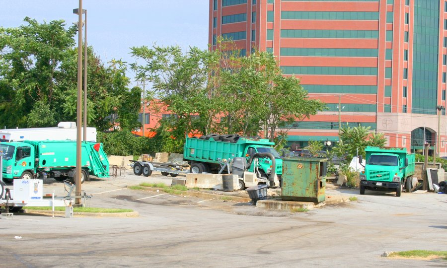 The DPW yard  and parking lot, a storage area for city equipment, from trucks to concrete barriers to utility vehicles.