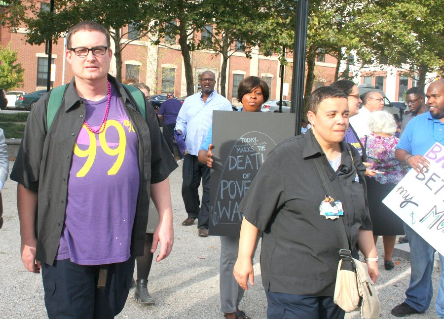 Wiley Rhymer and Simone Hicks, both Johns Hopkins Hospital employees, march in the