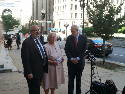 Heather Cook, with attorneys Jose Molia and David Irwin, outside the Mitchell Courthouse. (Photo by Ed Gunts)