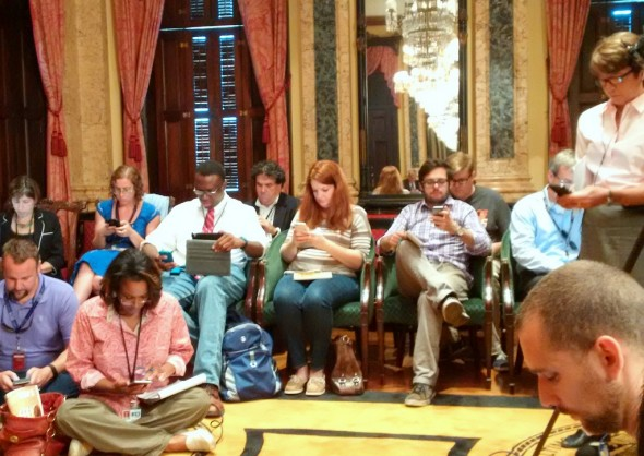 At City Hall, the press corps waits for Mayor Rawlings-Blake to enter. (Photo by Fern Shen)