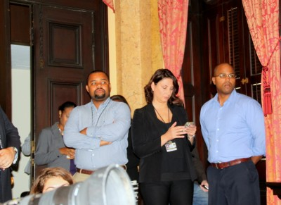 Chief of staff Kalliope Parthemos and other staffers await the mayor's announcement Friday. (Photo by Fern Shen)