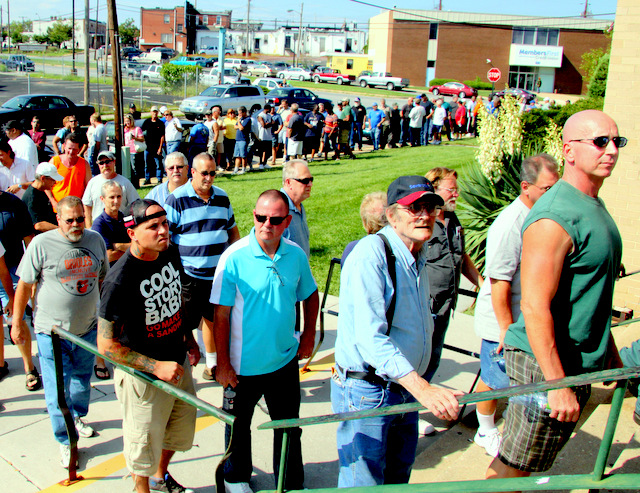 Steelworkers line up outside the union hall on Dundalk Avenue in August 2012 to learn that they no longer have jobs at Sparrows Point. (Photo by Fern Shen)
