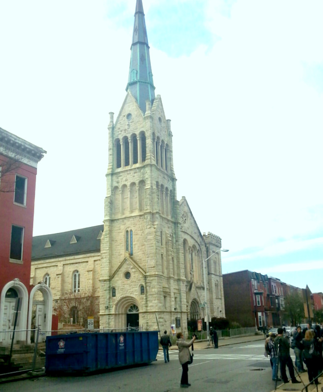The razed building (at left) is across the street from the Bethel AME Church. In the foreground, some of yesterday's demonstrators. (Photo by Ed Gunts)