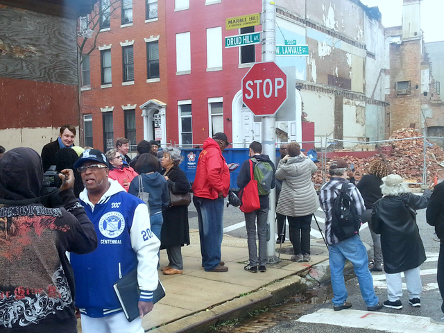 Demonstrators gather across the street from where the Cummings house was razed. (Photo by Ed Gunts)