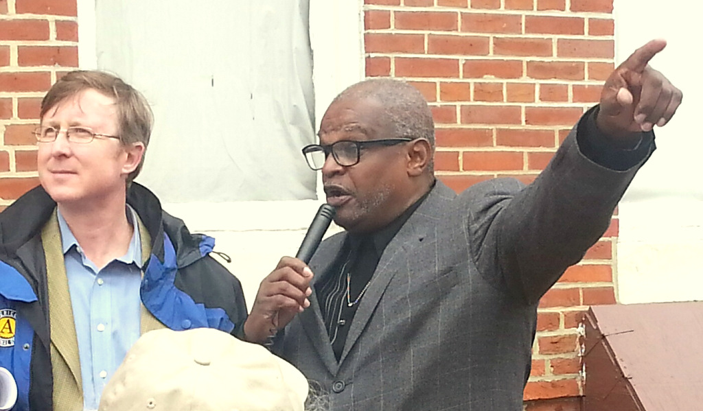 Baltimore Heritage director Johns Hopkins listens as Lou Fields addresses the demonstrators yesterday. (Photo by Ed Gunts)