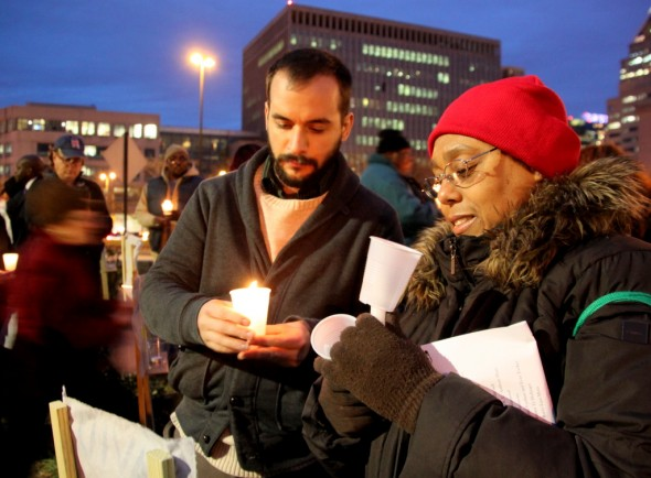 In downtown Baltimore, observing a tradition on the longest night of the year, people remembered homeless persons who died. (Photo by Fern Shen)