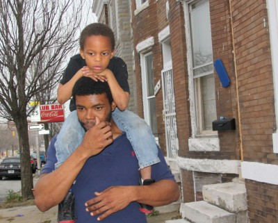 Omar Adams, with Khumari, 5, near Gilmor Elementary School.