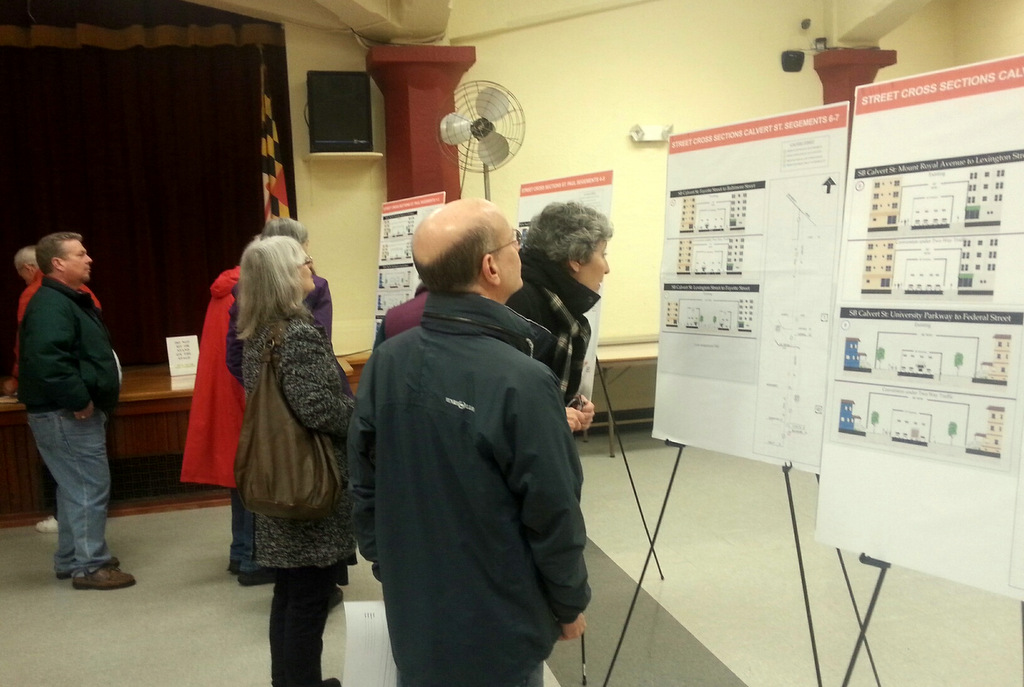 Citizens look at visual materials about traffic on St. Paul and Calvert streets before the presentation at Saints Philip and James Church in Charles Village. (Photo by Ed Gunts)