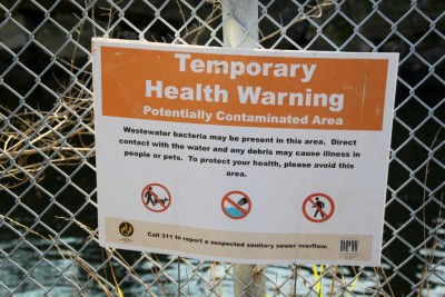Sign posted (within the last few weeks?) next to Outfall 67 along the Jones Falls Trail bike path on Falls Road. (Photo by Fern Shen)