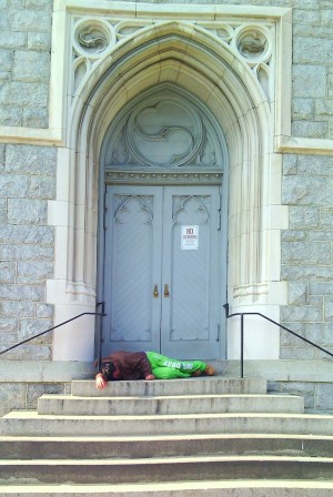 A passed out man on church steps in Upper Fells Point. (Photo: Victor Corbin)