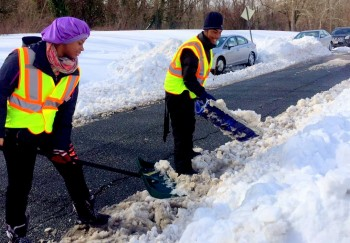 Participants in a city of Baltimore snow-shoveling program for 14-21-year-olds. (Photo: @BmoreDOT)