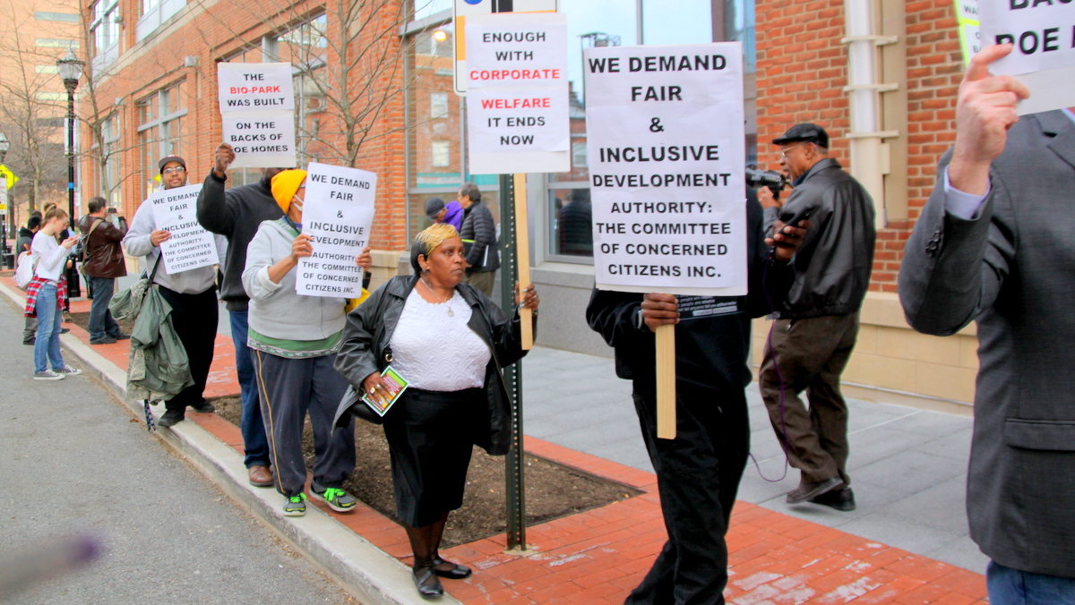 Protesters outside the University of Maryland BioPark said a$17M TIF financing deal offered residents and taxpayers little in return. (Fern Shen)