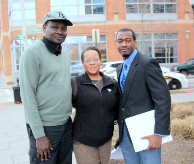 GOP candidates Larry Wardlow, Shannon Wright and Chancellor Torbit at Tuesday's Poe Homes protest. (Photo by Fern Shen)