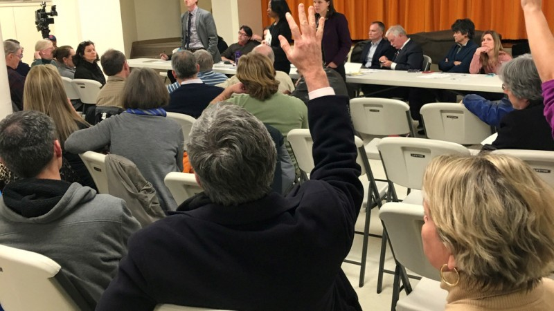 Mac Kennedy raises his hand with a question to DOT officials, as his wife Kim looks on. (Larry Perl)
