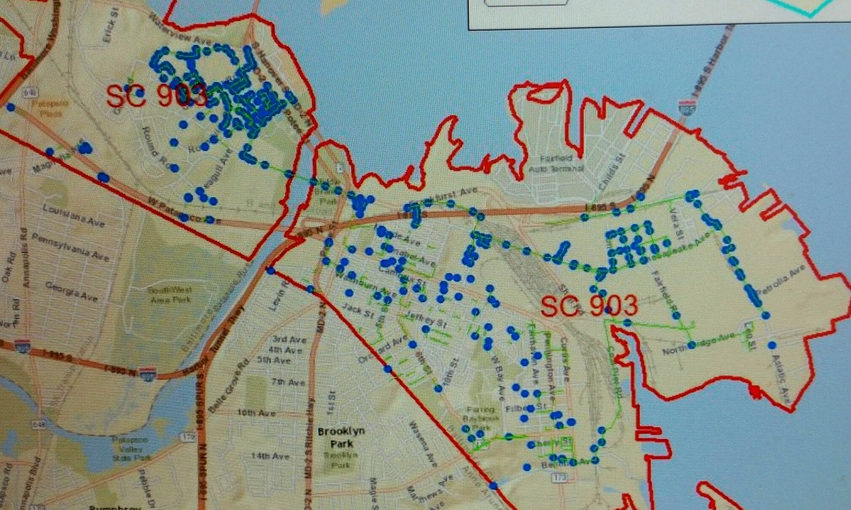 The map shows sewer lines to be repaired (green lines) and manholes (blue dots) to be replaced or rehabilitated. (Baltimore Department of Public Works)