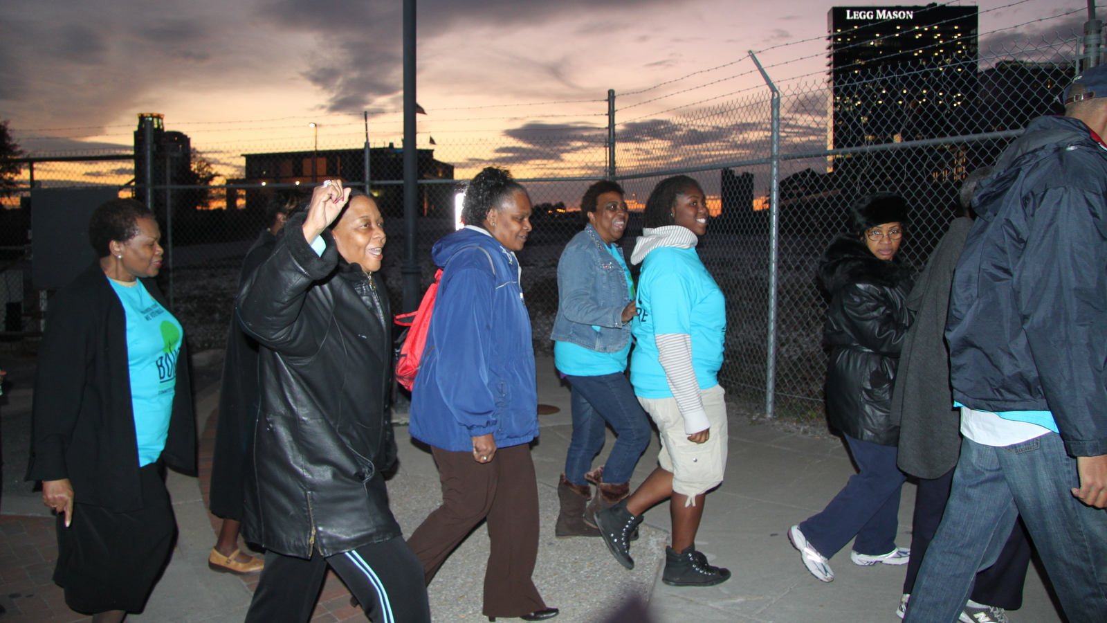 Members of BUILD (Baltimoreans United in Leadership Development) pass the future site of Harbor Point in 2011 on their way to protest city subsidies given to John Paterakis' upscale Harbor East development. (Fern Shen)
