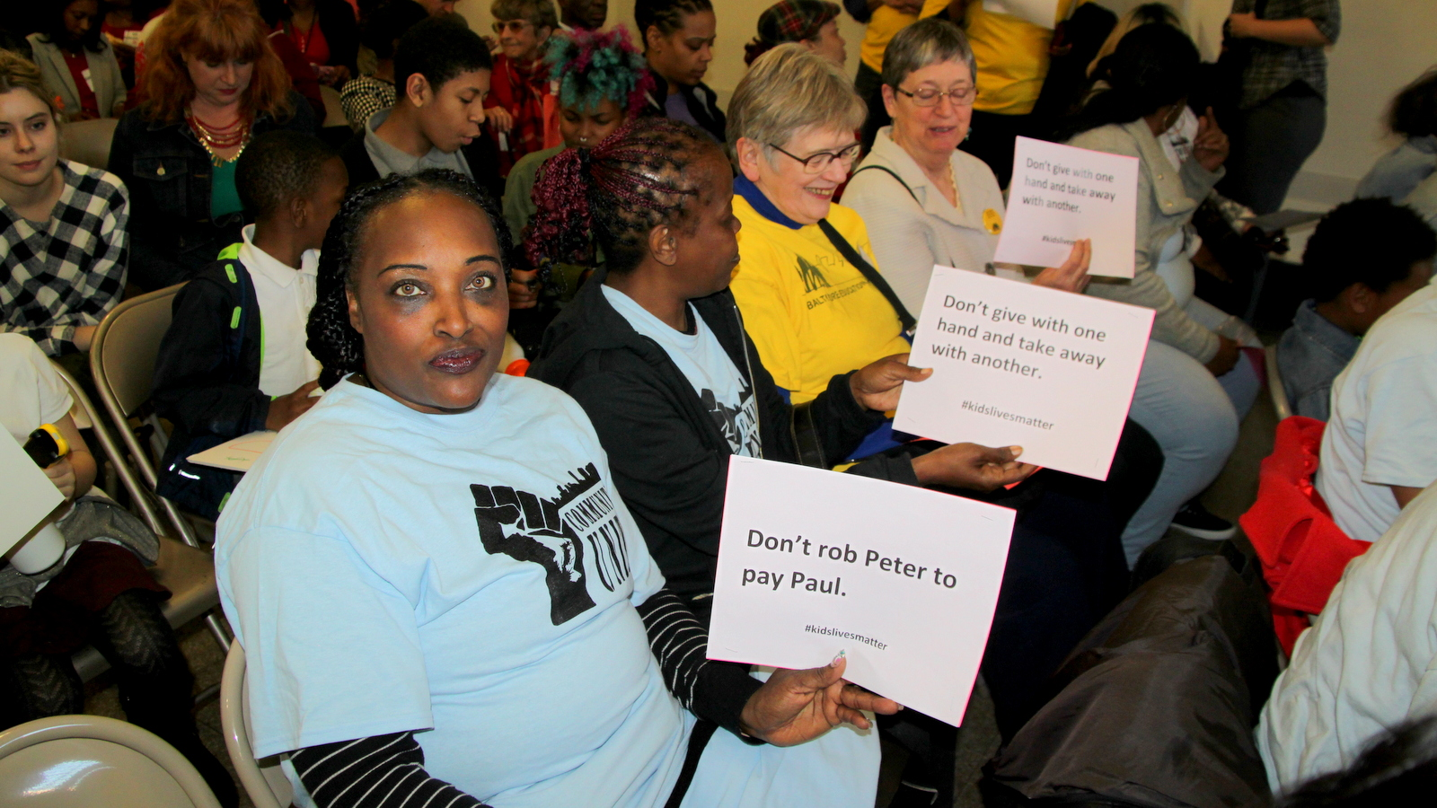 Advocates opposing cuts in funding for education and after-school programs. (Fern Shen)