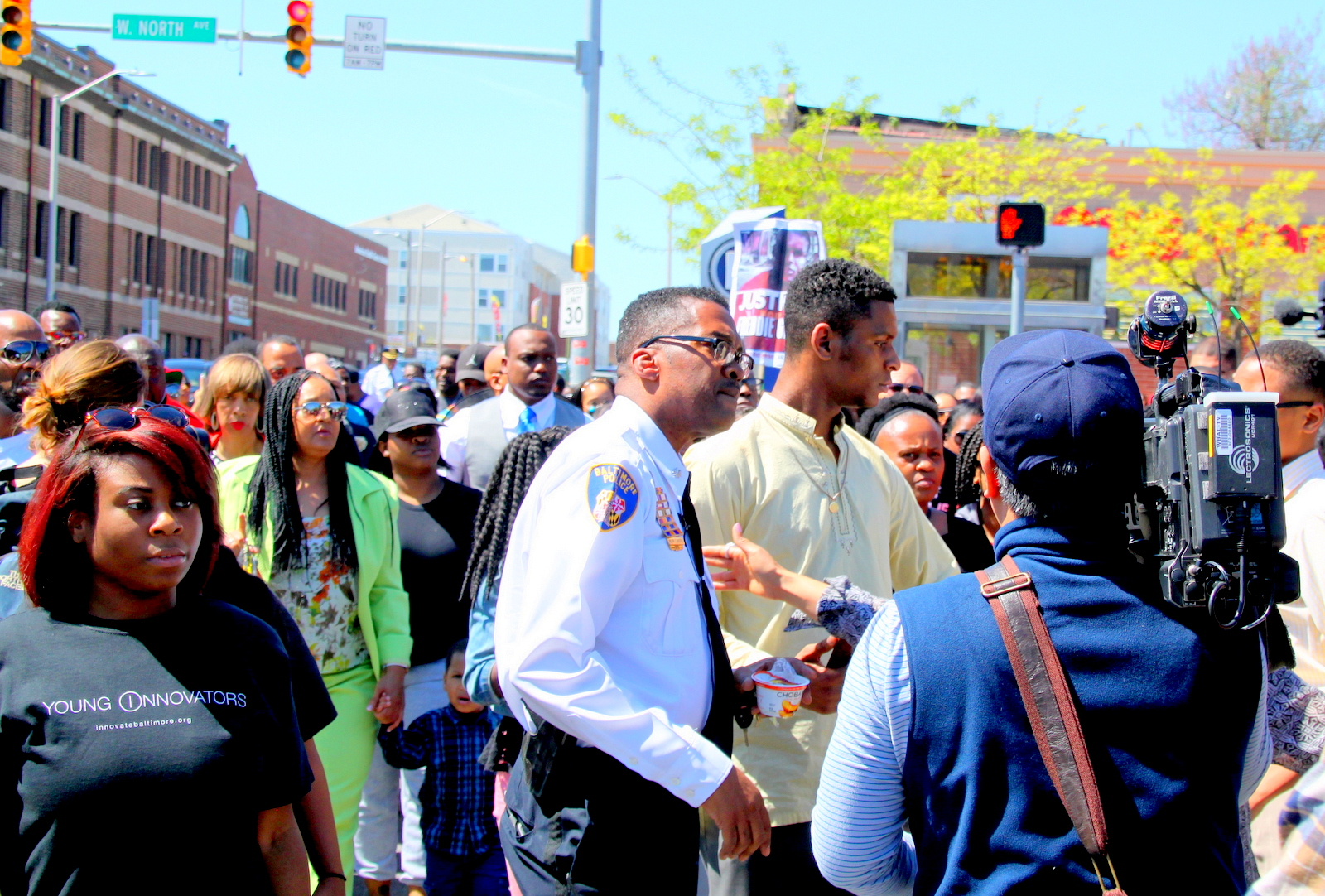 Lt. Col. Melvin Russell directing the crowd at Sunday's Unity March at Penn-North. (Louie Krauss)