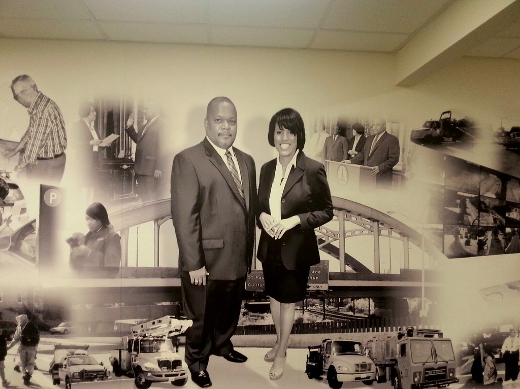 Celebrating DOT's mission, its leader and his boss on a wall at department headquarters at 417 E. Fayette Street. (Ed Gunts)