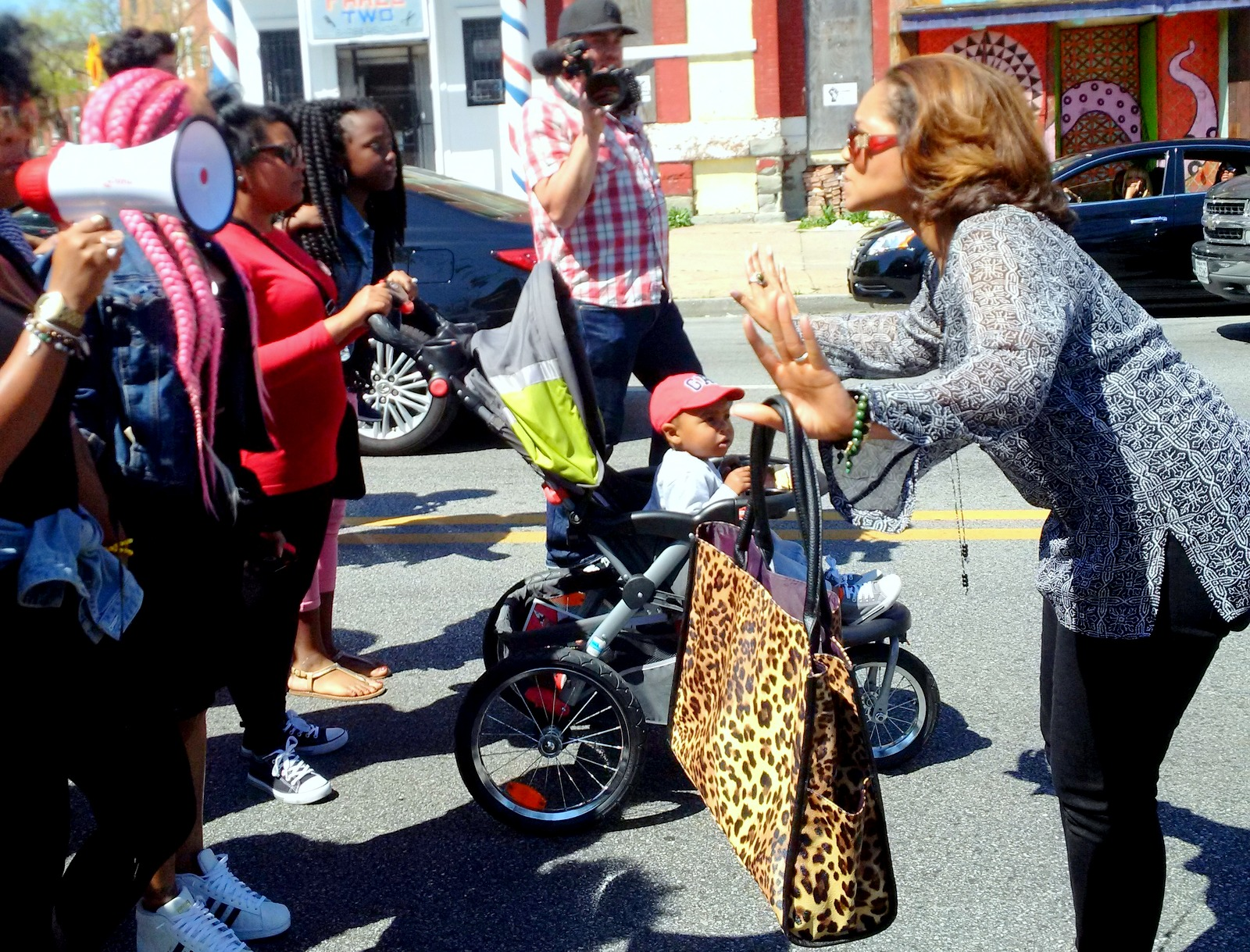 Empowerment Temple publicist Nicole Kirby directing marchers. (Louie Krauss)