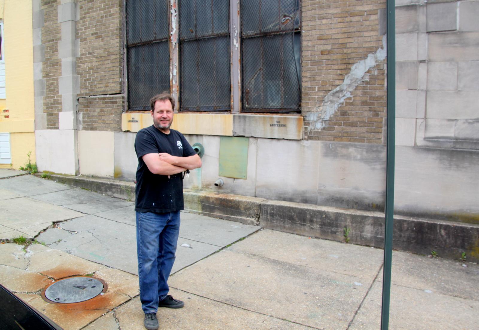 Joe Clancy has watched cracks appear in sidewalk and walls at 439 East Preston Street. (Fern Shen)