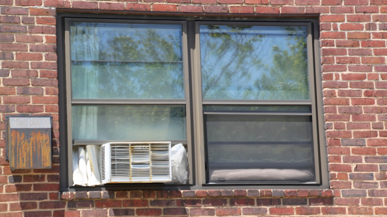 Among the repair problems Perkins Homes residents cited was broken windows and air conditioners. (Fern Shen)