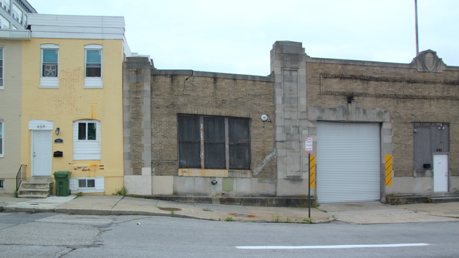 Directly across from 428 East Preston, the Old Post Office Garage building is also slumping. (Fern Shen)