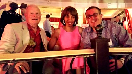 Catherine Pugh shares a laugh with James T. Smith (left) at the Maryland Part in Las Vegas last month. to Pugh's left is Caves Valley Partners principal Arsh Mirmiran. (Melody Simmons, Baltimore Business Journal)