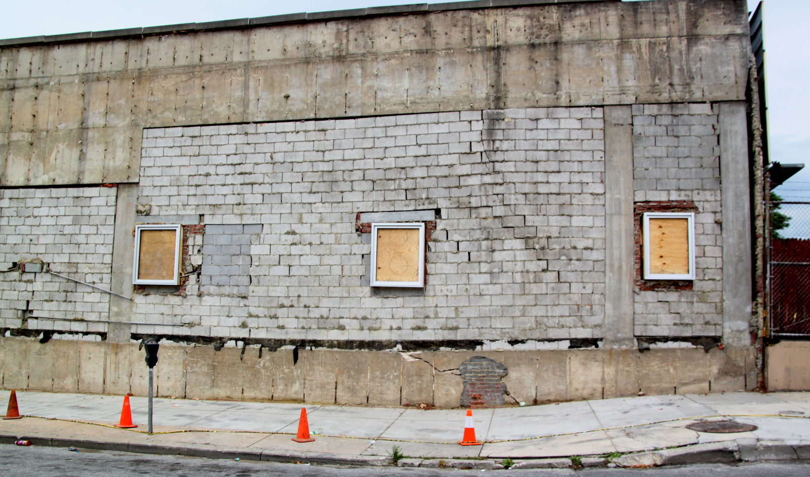Stabilized with piers, the Preston Street building will have its facade re-applied soon. (Fern Shen)