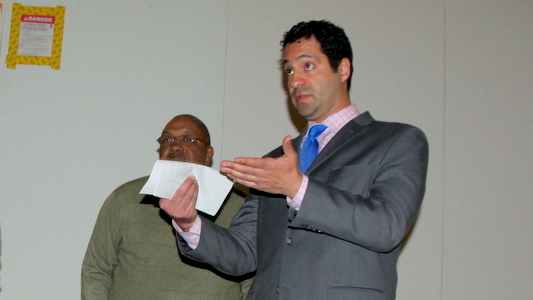 Tom Akras, executive secretary of the Baltimore Liquor Board, at a February community meeting. (Fern Shen)