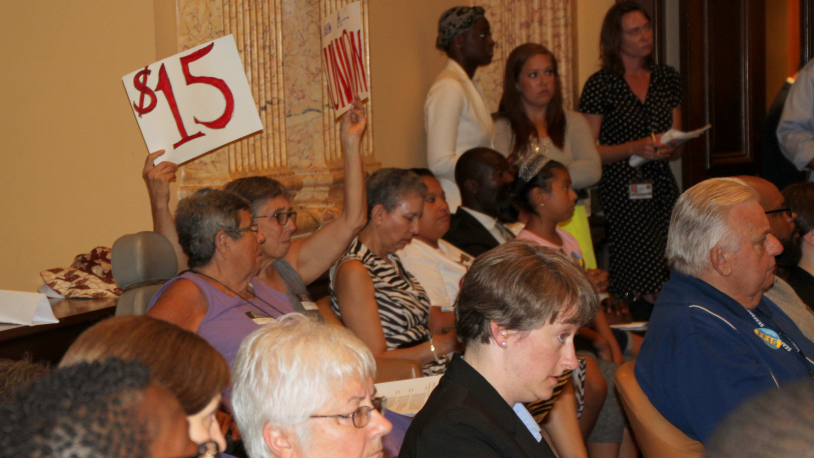 Advocates of the $15 an hour minimum wage lobbied hard for the measure tonight. (Fern Shen)