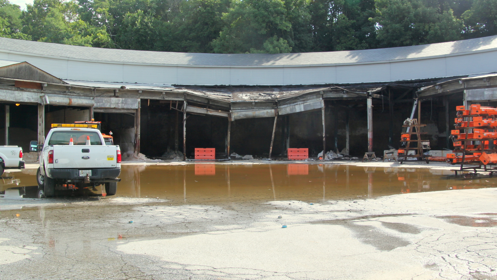The old railroad roundhouse, used by the city to store salt, had a lake in the parking lot Sunday morning. (Fern Shen)