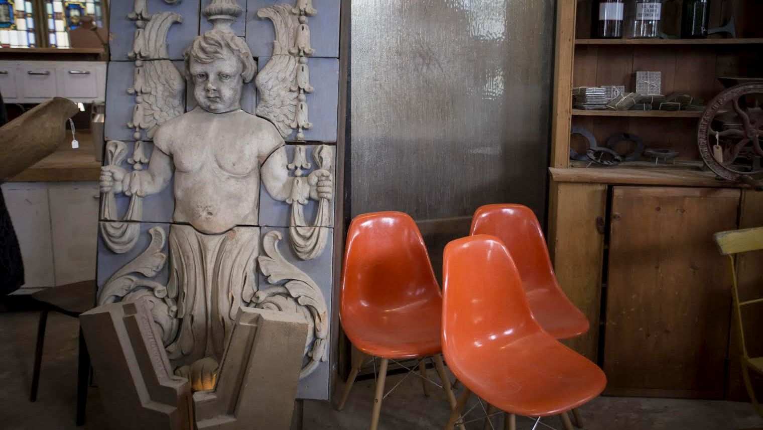 Cherub and chairs. From Housewerks Architectural Salvage. (Jennifer Bishop)