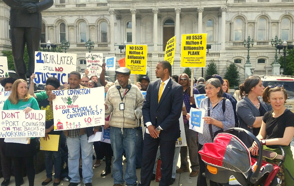 Joshua Harris stands with demonstrators in front of City Hall last May, who were protesting the city's proposed TIF tax subsidy to Kevin Plank's Port Covington project. (Mark Reutter)