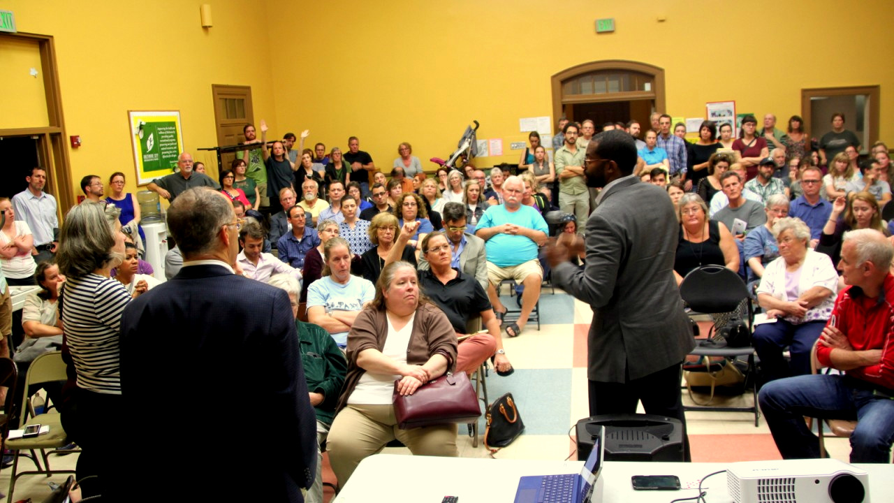 On Tuesday night, residents cram into a meeting room to hear Councilman Nick Mosby talk about zoning plans for a proposed conversion of the Pepsi plant in Woodberry. (Fern Shen)
