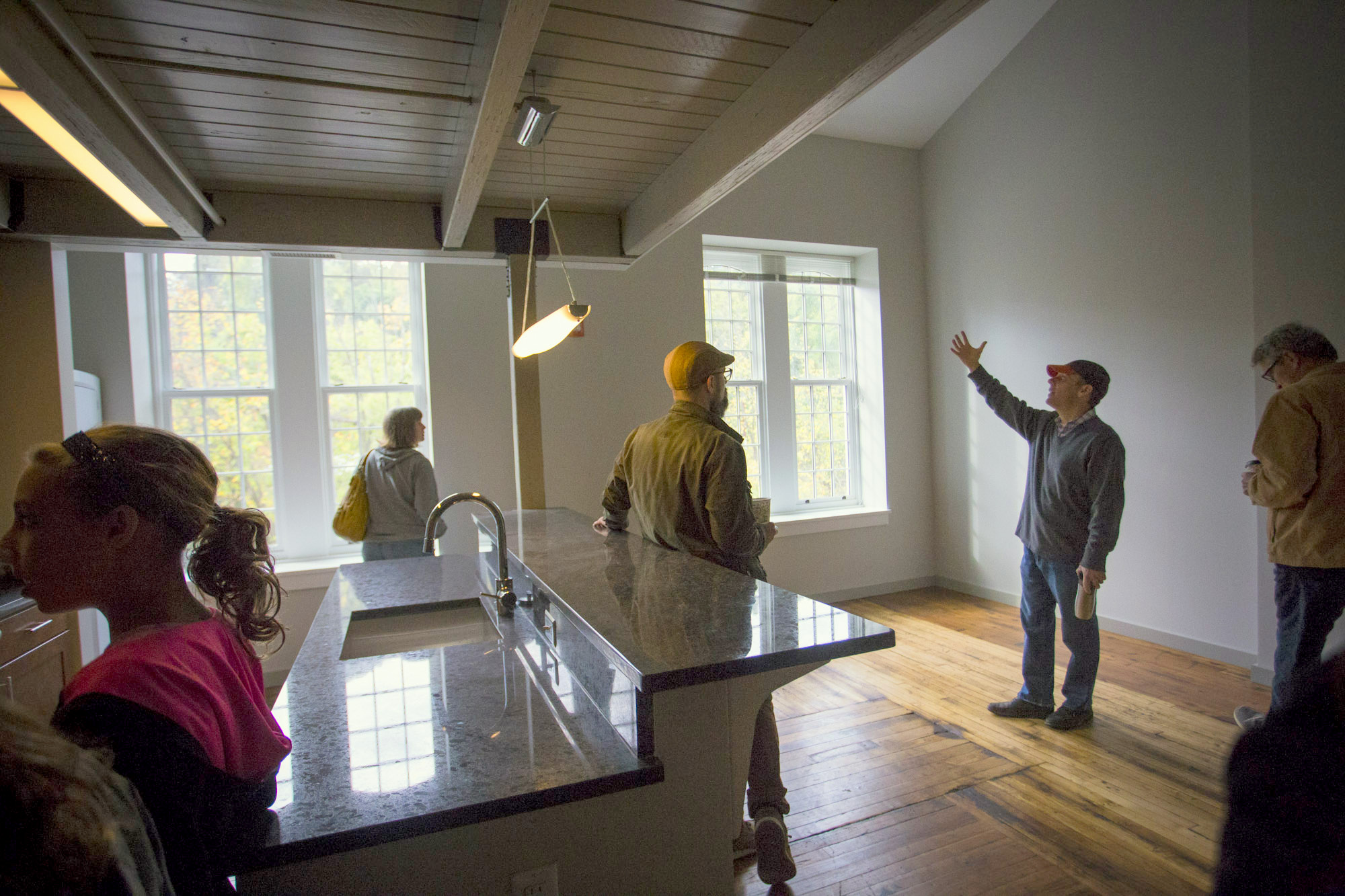 Visitors tour one of the apartments at Whitehall Mill. (Jennifer Bishop)