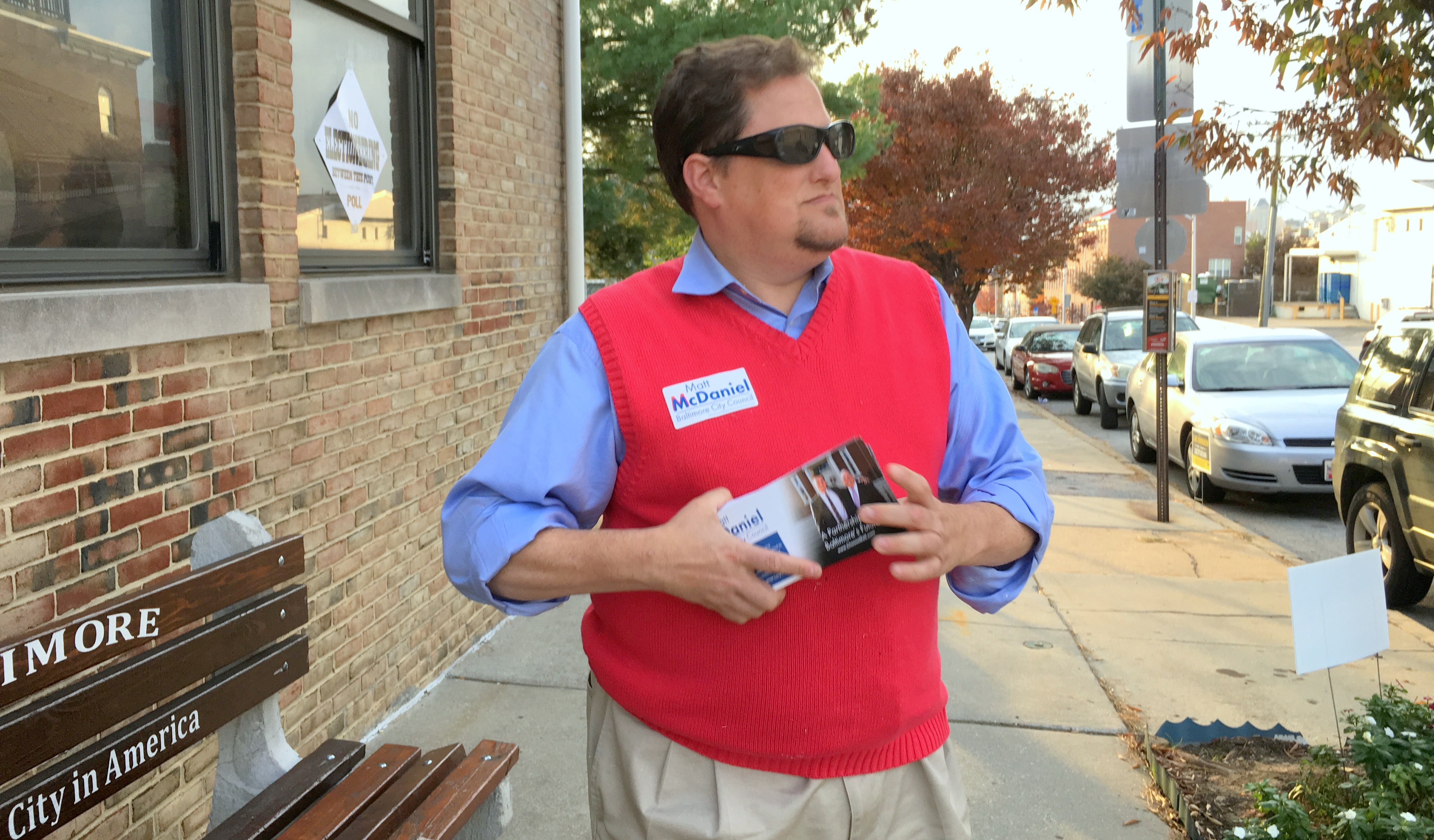 George Faber, of Baltimore County, hands out literature for Republican City Council candidate Matt McDaniel outside a Southeast Baltimore polling place. (Fern Shen)