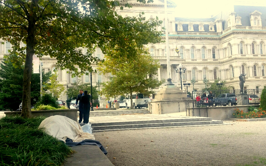 A homeless person sleeps in front of City Hall yesterday afternoon. (Mark Reutter)