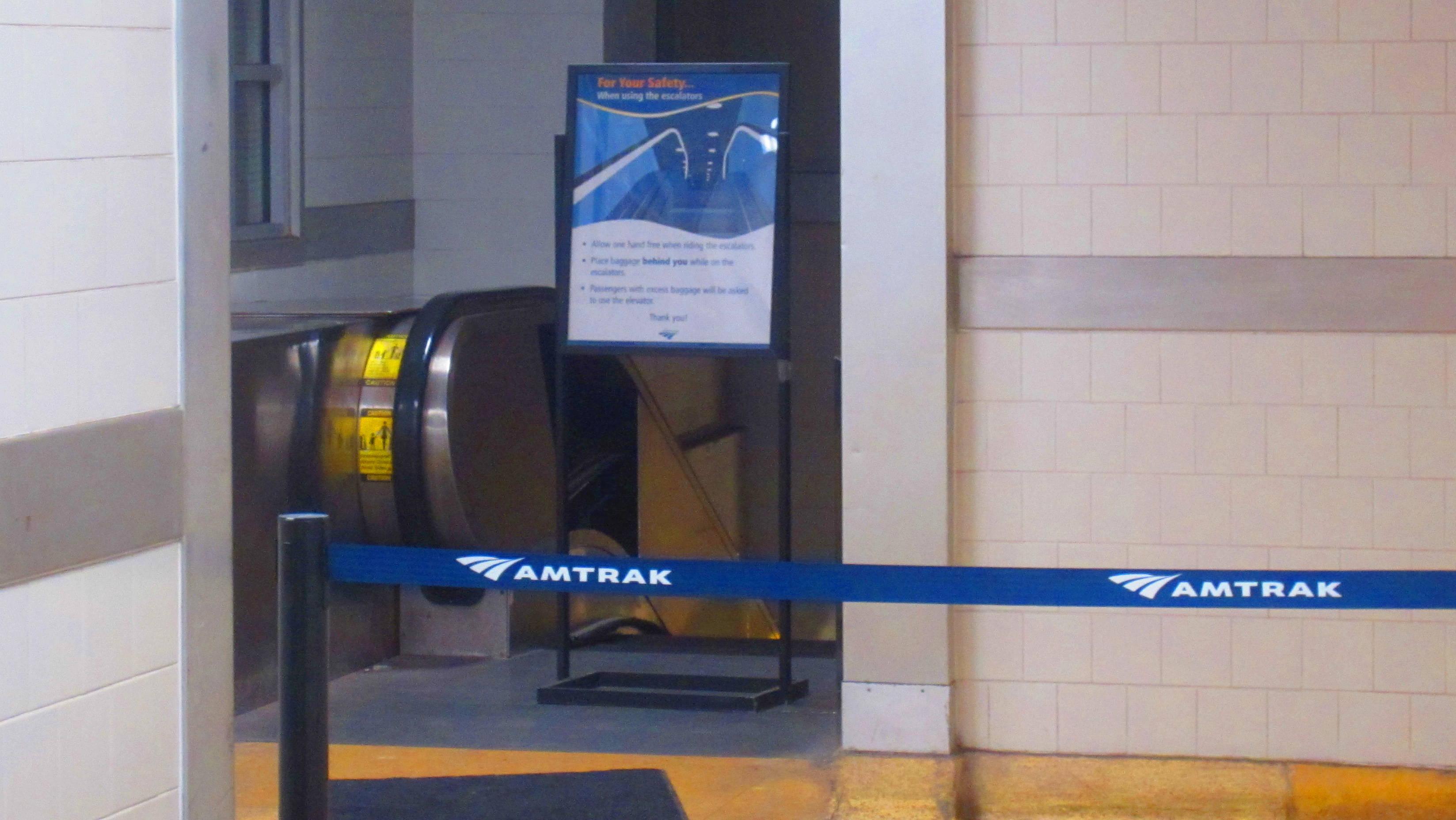 The blocked-off Penn Station escalator, viewed from the lobby level. (Scott Klinger)