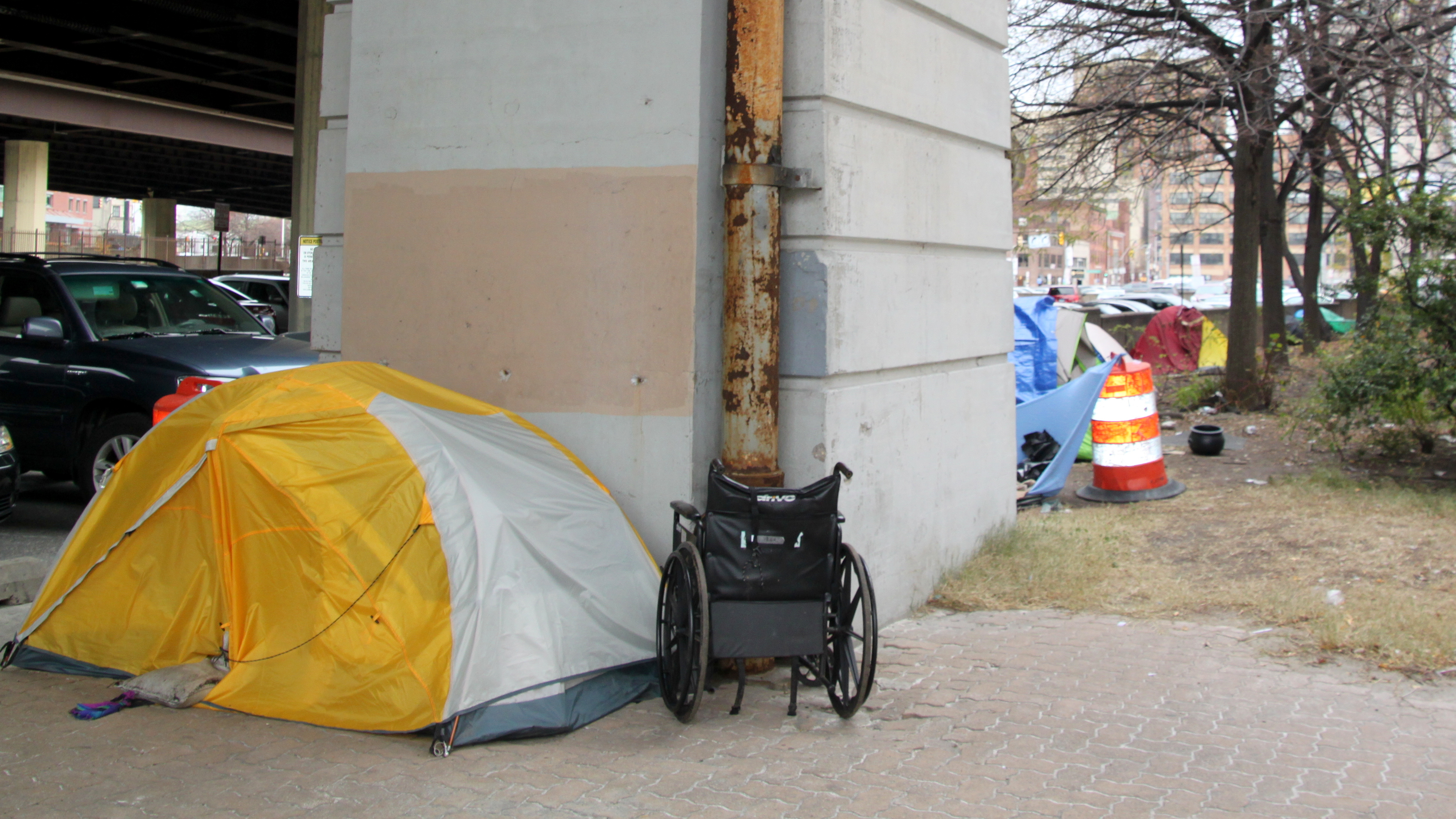 Tents where people sleep along Guilford Avenue, near Baltimore City Hall. (Fern Shen)