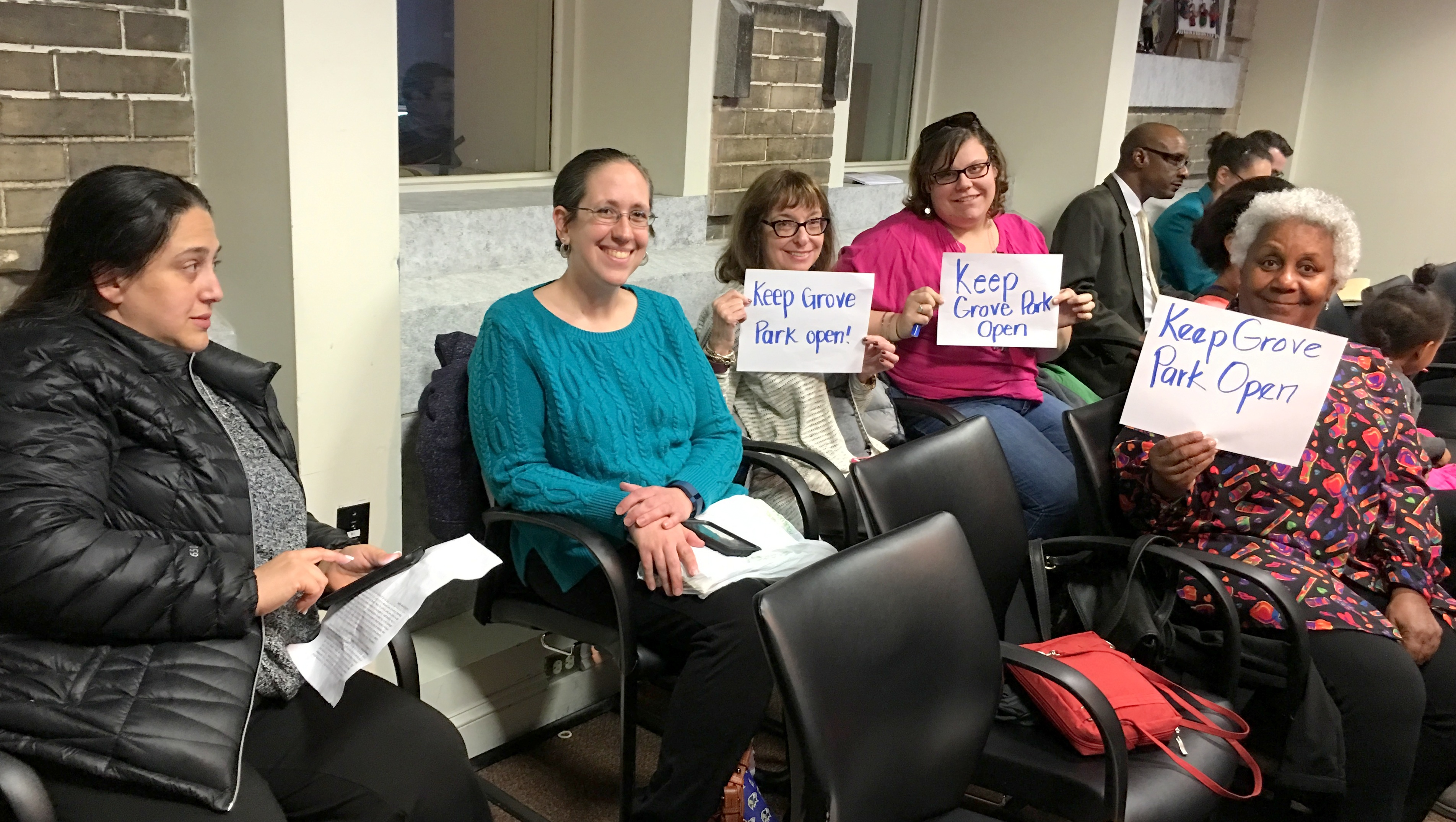 Jennifer Mccarty (blue sweater) and other Grove Park Elementary teachers at Tuesday School board hearing. (Fern Shen)