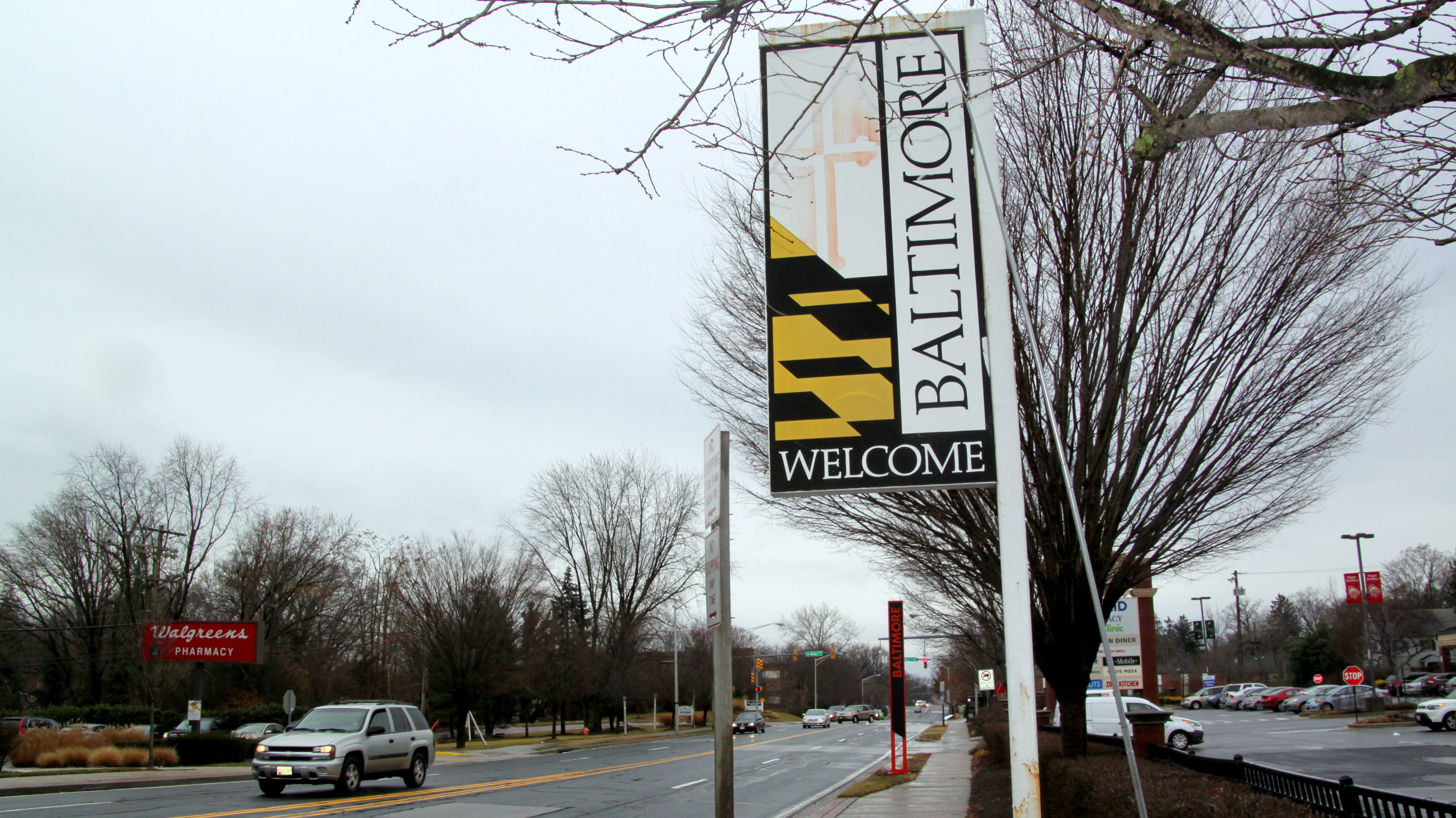 The city will replace or remove old Baltimore entrance signs like this flag-emblazoned