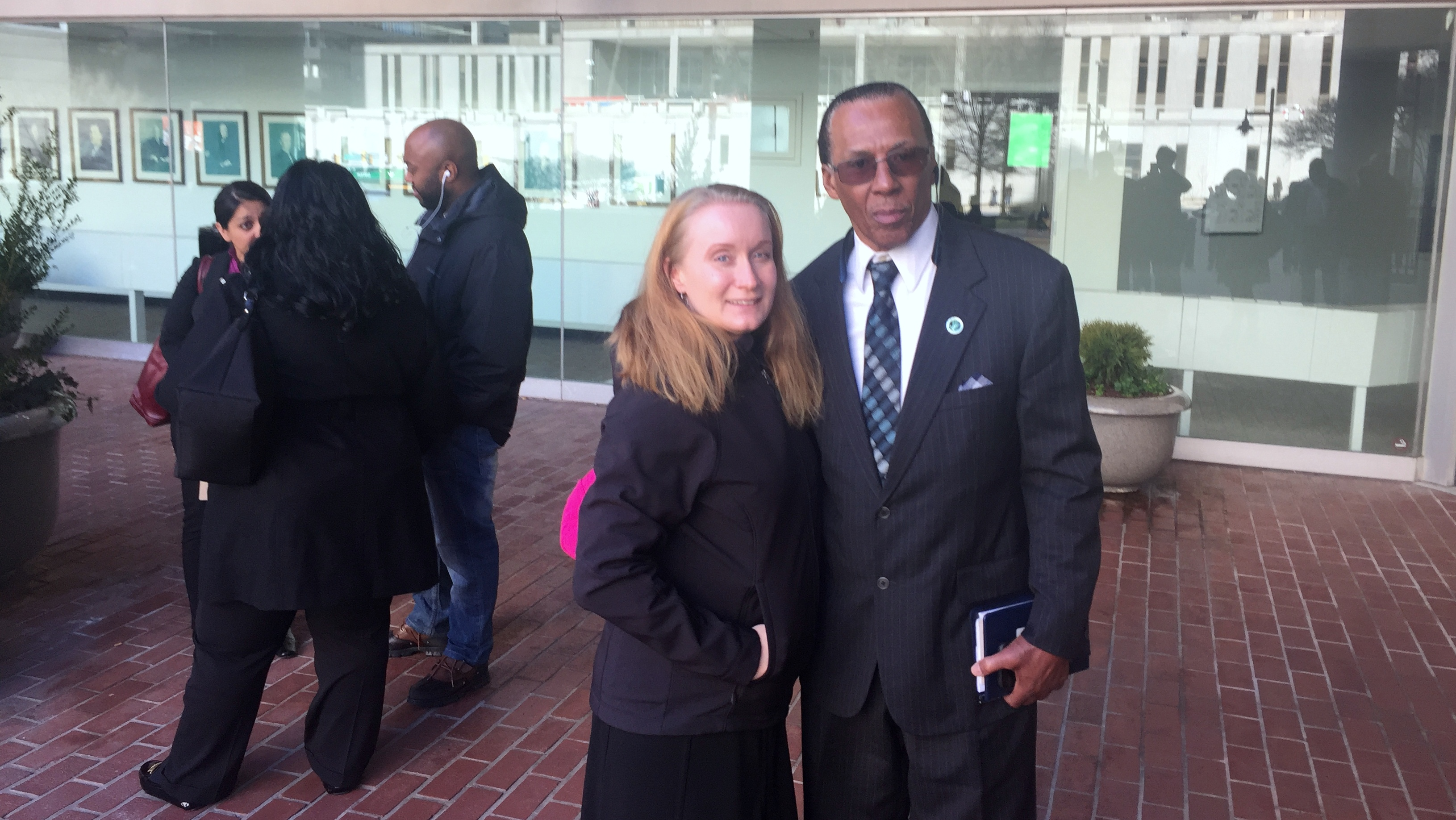 Walter Lomax, executive director of the Maryland Restorative Justice Initiative, with the ACLU's Meredith Curtis, outside federal court in Baltimore. (Louie Krauss)