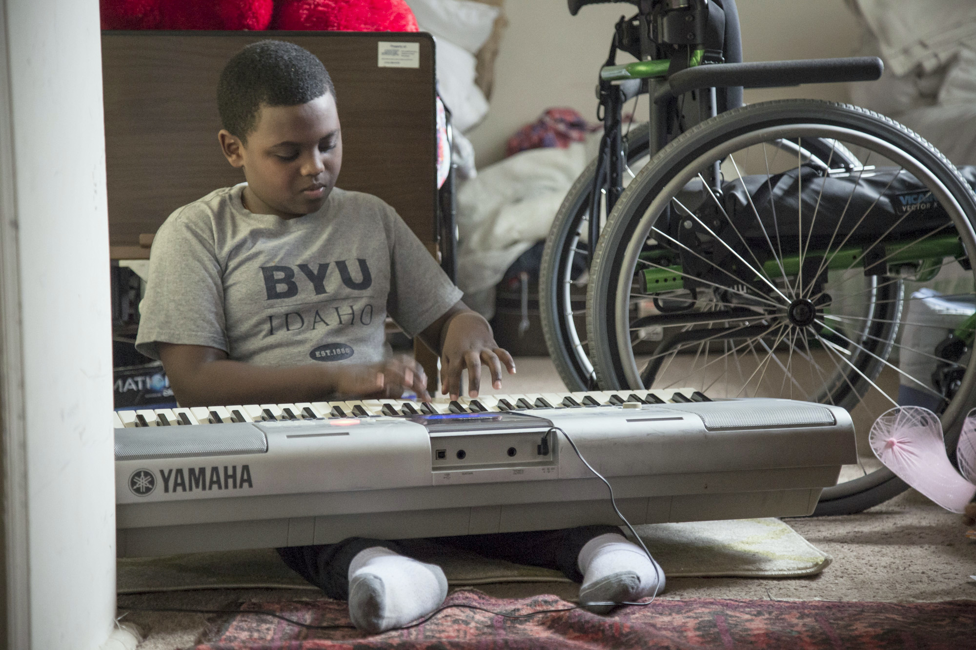 Natan Tsegay, now 10, has been unable to walk since falling ill in an Ethiopian refugee camp when he was 7. (Jennifer Bishop)
