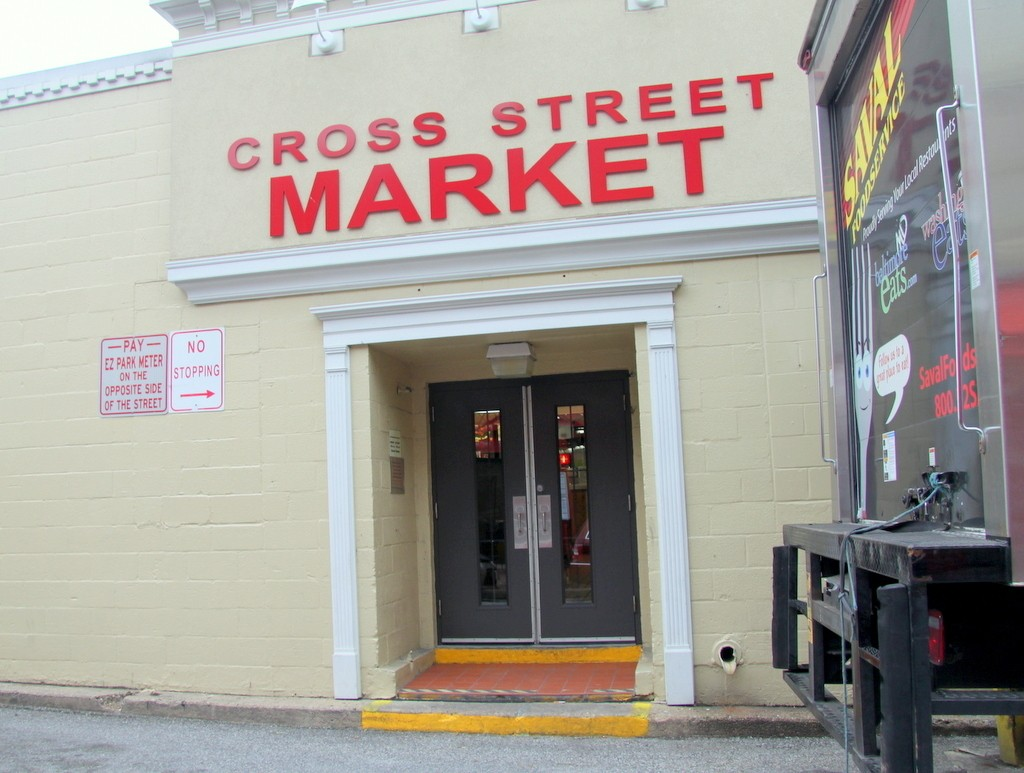 Amid controversy over its planned makeover of Cross Street Market, the developer had said it was washing its hands of the deal. (Fern Shen)
