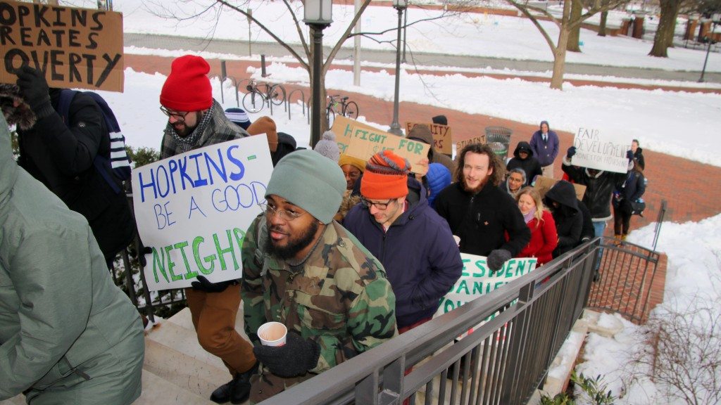 Johns Hopkins University contract workers need help to afford to live near their work, Terrel Askew (in blue hat) said. (FernShen)
