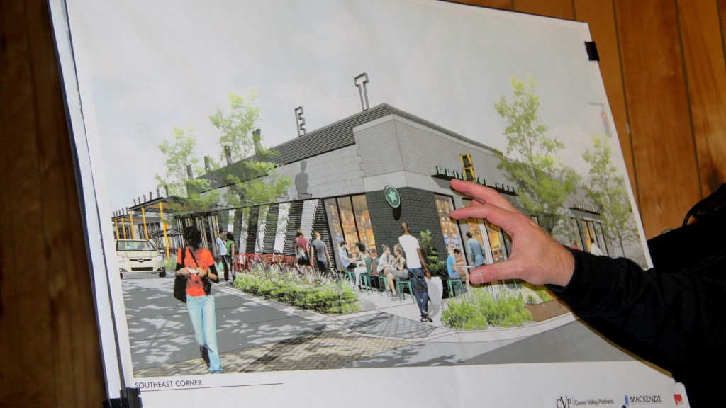 At a community meeting in January, Arsh Mirmiran with a mock-up of how the renovated Cross Street Market would look. (Fern Shen)